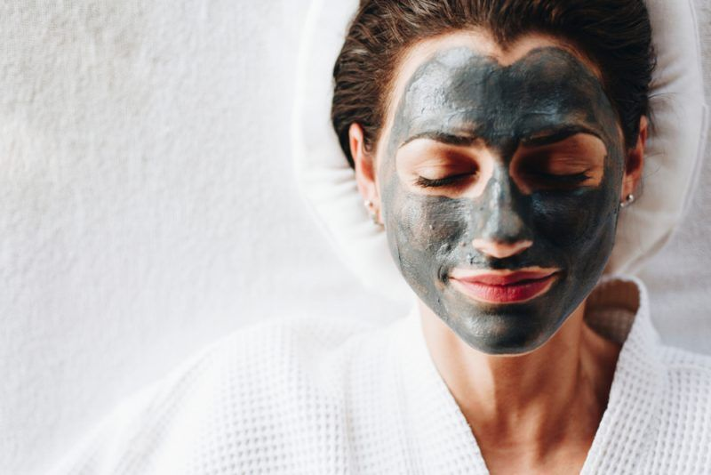 woman with a face mask spa treatment