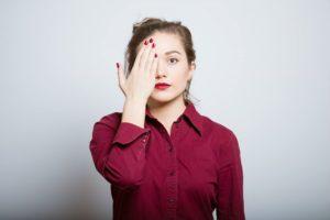 girl-covering-eye