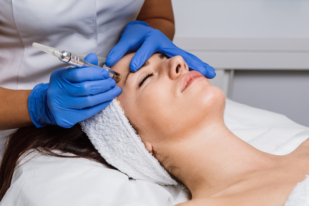 woman receiving a medical facial treatment at a spa