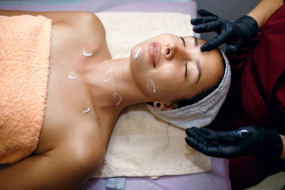 woman receiving a facial treatment at a spa