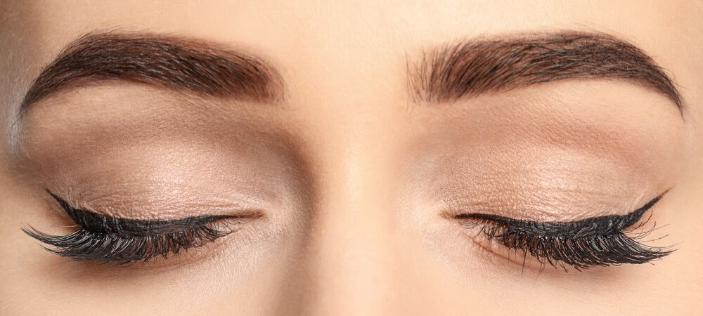 close up of womans eyebrows and eyes