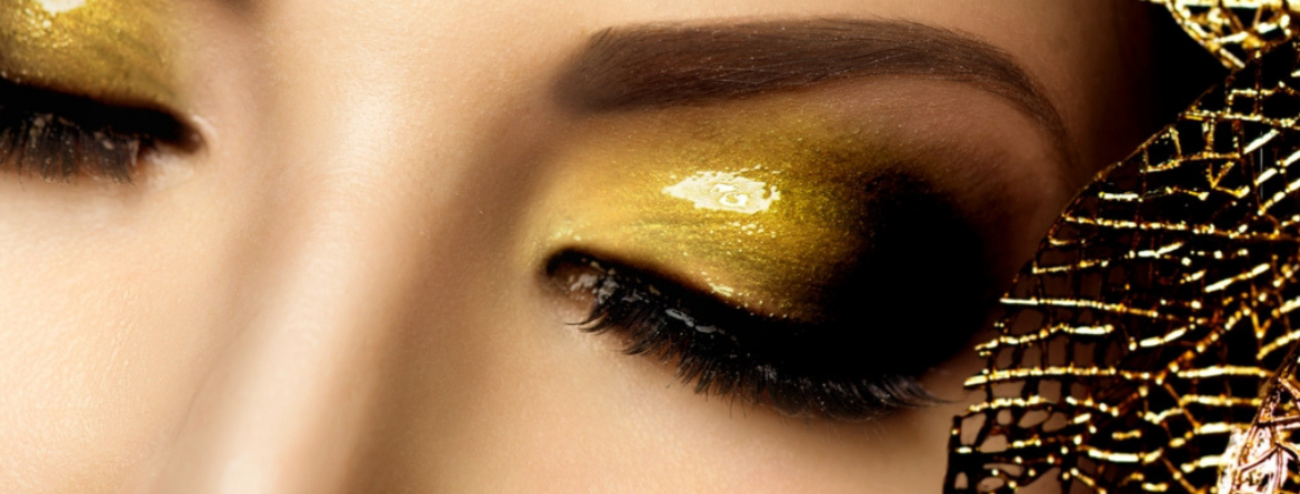 closeup of eyes with gold eyeshadow and long lashes