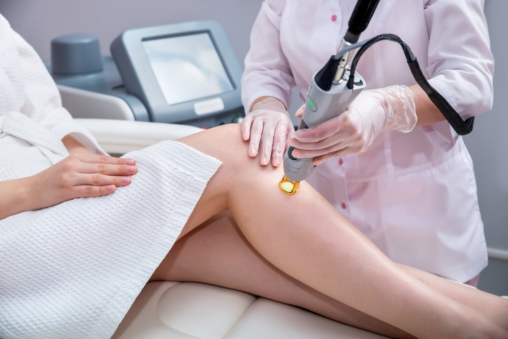 Client receiving laser hair removal.