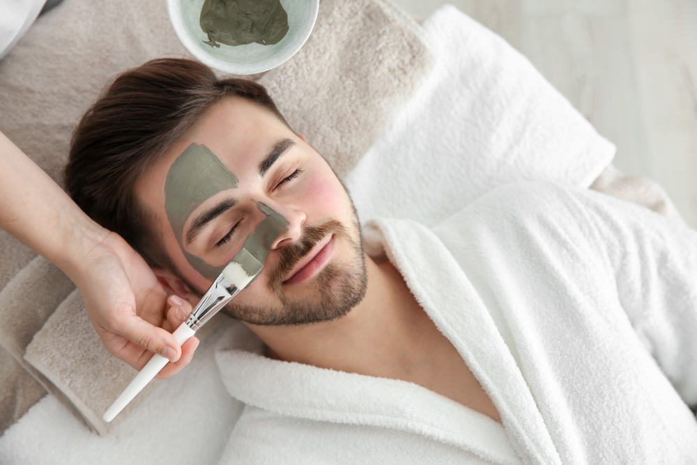man receiving a facial